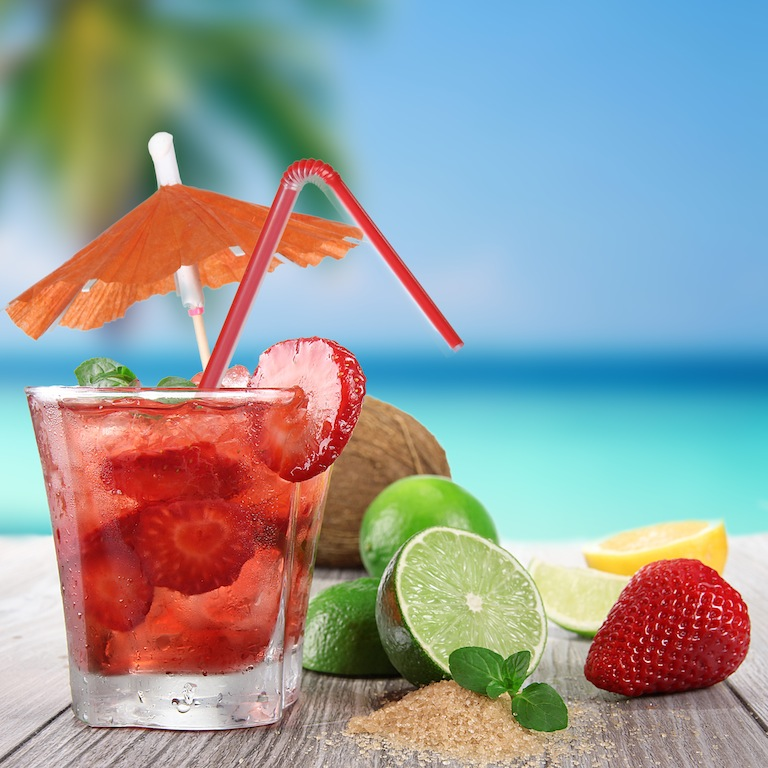 Fresh fruit cocktail on a beach